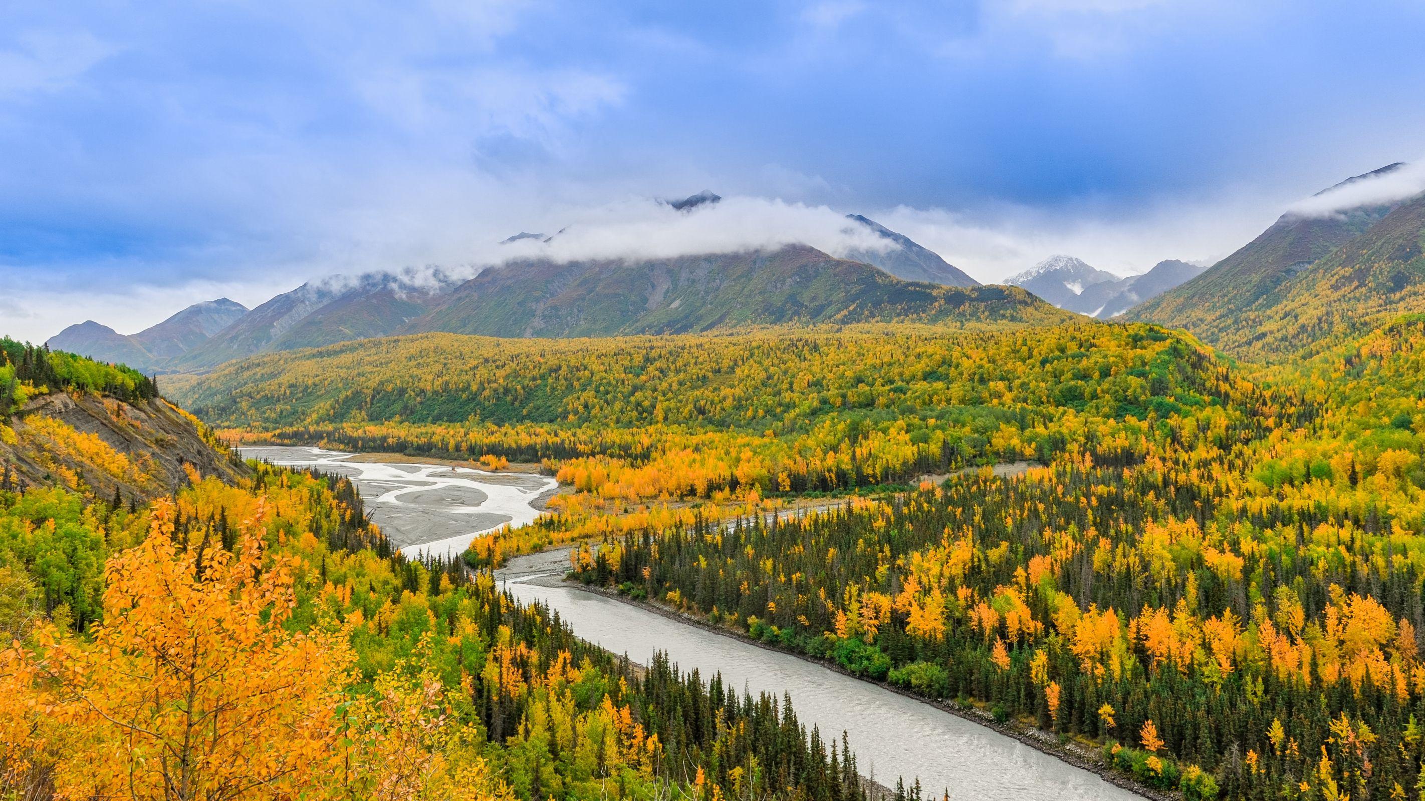beautiful long river between mountains in alaska