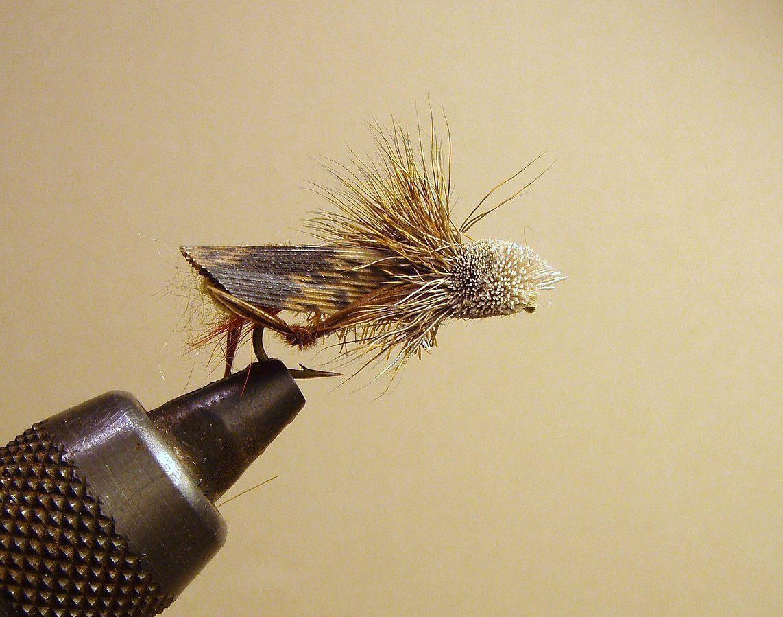 A dry fly imitating a grasshopper