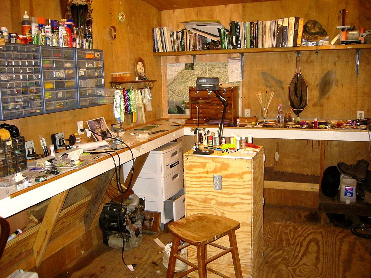 A fly tier's work area complete with kits